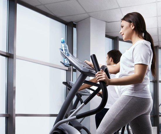 image of a lady working out on elliptical