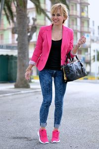 image showing fit woman with Blue Skinny Jeans with Pink Running Shoes