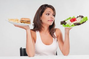 woman struggling to decide whether to diet