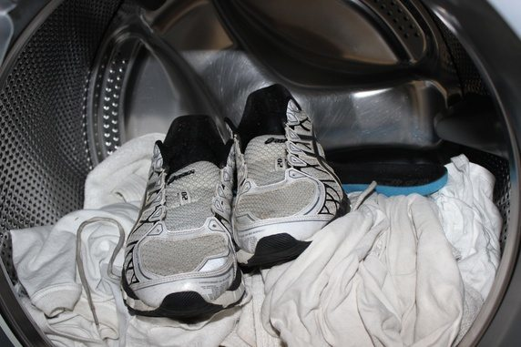 muddy shoes being cleaned in a washer