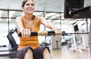 woman on an indoor rower