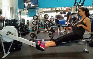 picture of a woman working out in a gym