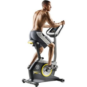 man losing weight on an exercise bike