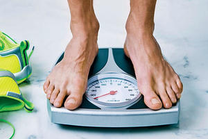 man standing on a weight scale