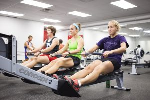 gym bunnies rowing in a group