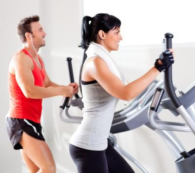 couple exercising on the elliptical